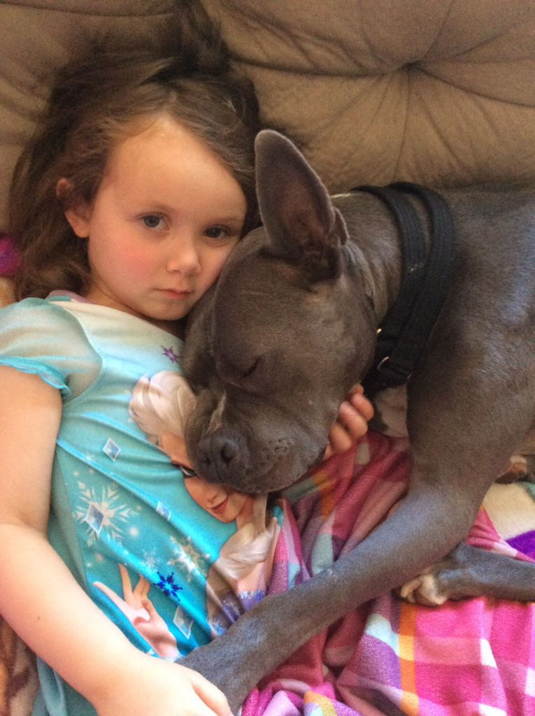 Argo with his best friend, a little girl
